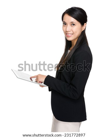 Businesswoman use of digital tablet - stock photo