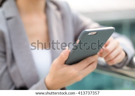 Businesswoman use of mobile phone - stock photo