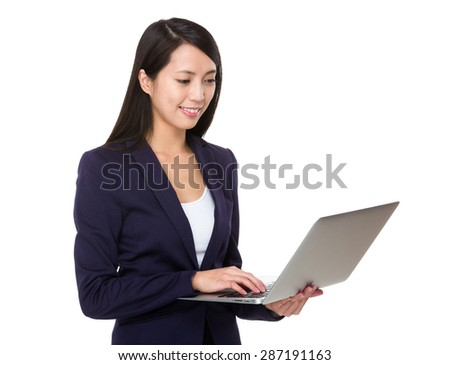 Businesswoman use of portable computer - stock photo