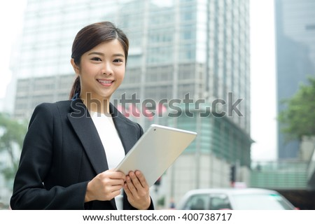 Businesswoman use of tablet pc - stock photo
