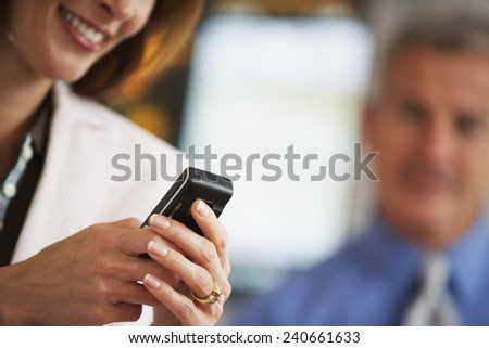 Businesswoman Using a Cell Phone - stock photo