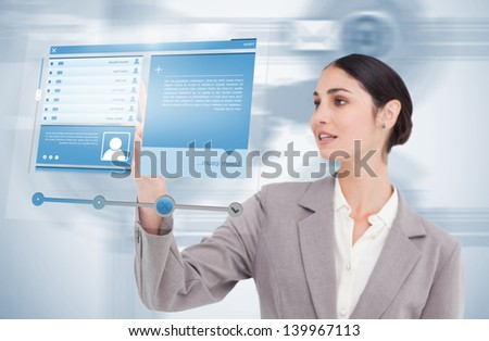 Businesswoman using futuristic hologram to view social media profile on blue background - stock photo