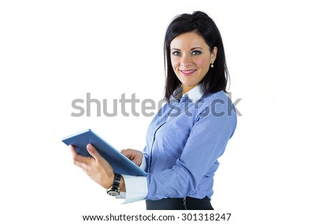 Businesswoman using her tablet pc on white background - stock photo