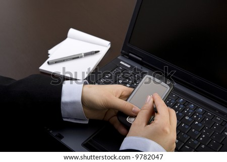 businesswoman using modern pda in office - stock photo