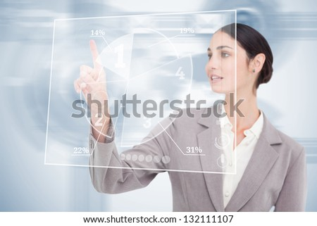 Businesswoman using nice transparent futuristic interface  with her fingertip - stock photo