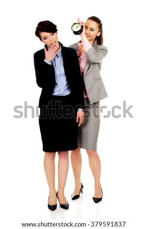 Businesswoman waking up her partner. - stock photo