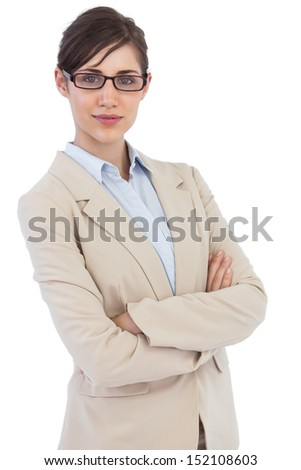 Businesswoman wearing glasses against white background - stock photo