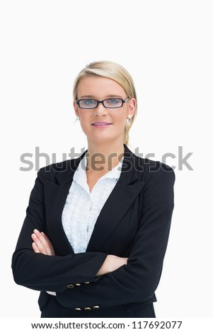 Businesswoman wearing glasses with crossed arms - stock photo