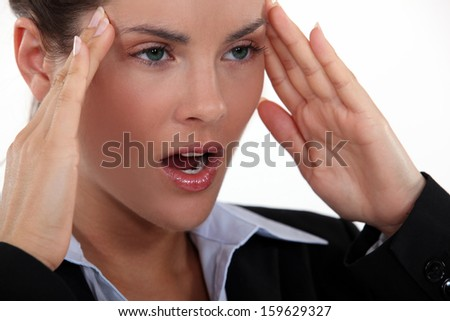 Businesswoman with a bad headache. - stock photo