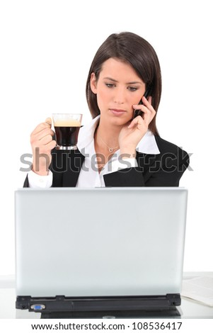Businesswoman with a cup of coffee - stock photo