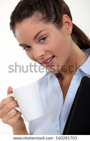 Businesswoman with a hot drink - stock photo