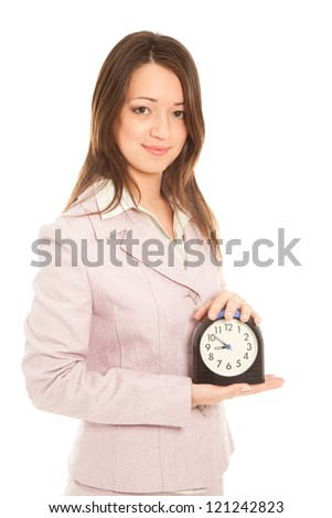 Businesswoman with alarm clock isolated on white - stock photo