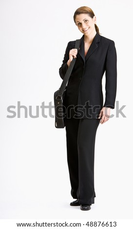 Businesswoman with briefcase - stock photo