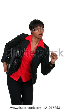 Businesswoman with briefcase about to run - stock photo