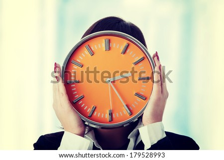 Businesswoman with clock - time concept - stock photo
