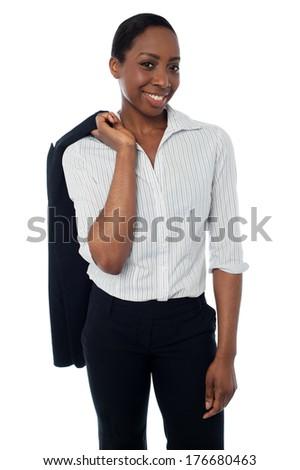 Businesswoman with coat slung over her shoulder - stock photo