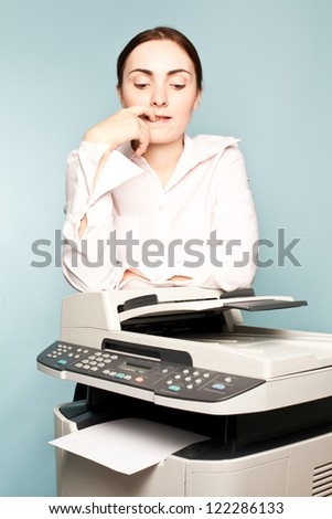 Businesswoman with copier thinking on the blue background - stock photo
