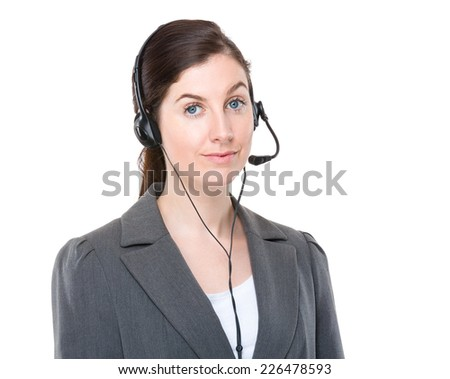 Businesswoman with customer services headset - stock photo