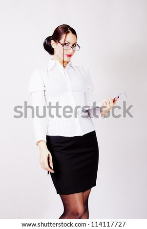 Businesswoman with eyeglasses holding a contract paper - stock photo