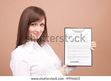 Businesswoman with files isolated on beige - stock photo
