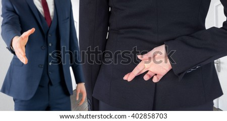 Businesswoman with fingers crossed behind her back against doodle office in hallway - stock photo