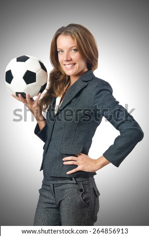 Businesswoman with football on white - stock photo