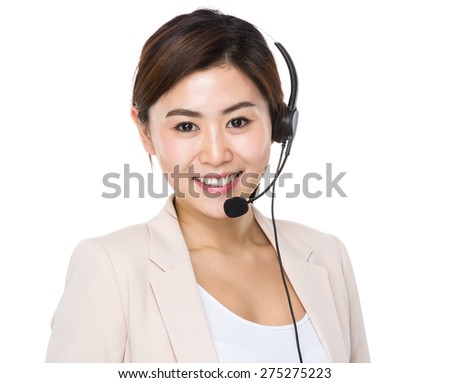 Businesswoman with headset for supporting servies - stock photo