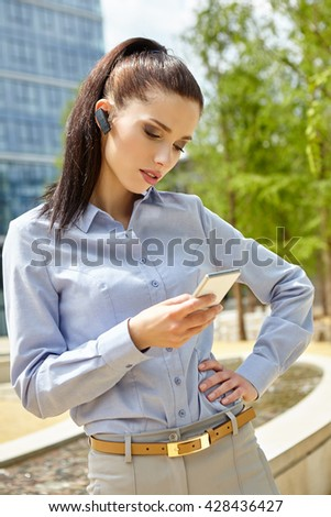 Businesswoman with  headset phone - stock photo
