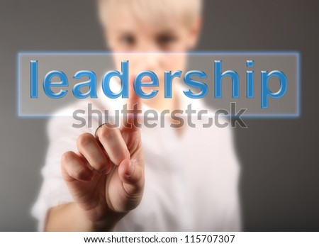 Businesswoman with leadership sign - business concept - stock photo