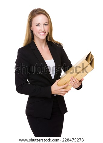 Businesswoman with lots of file pad - stock photo