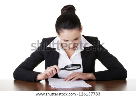 Businesswoman with magnifying glass analyze contract, isolated on white - stock photo