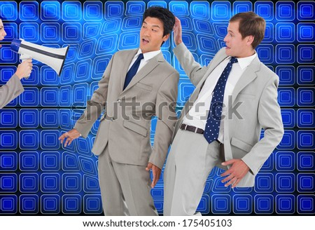 Businesswoman with megaphone yelling at colleagues against abstract technology background - stock photo