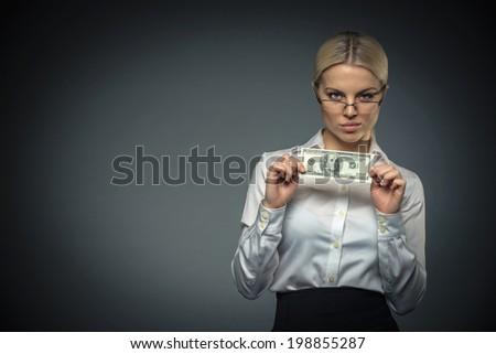 Businesswoman with money in studio - stock photo