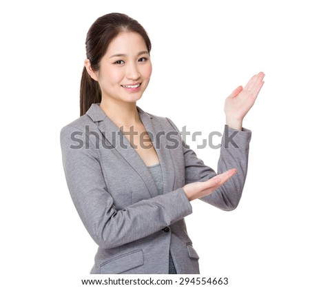 Businesswoman with open hand palm - stock photo
