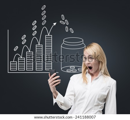 businesswoman with phone and drawing bank with money on wall - stock photo