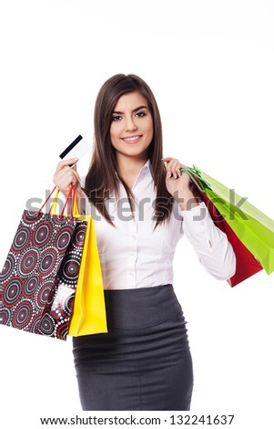 Businesswoman with shopping bag and credit card - stock photo