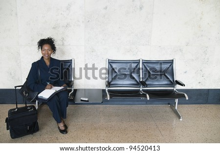 Businesswoman with suitcase - stock photo