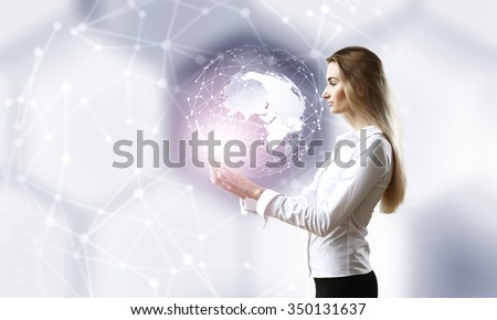 Businesswoman with tablet pc against high tech background - stock photo