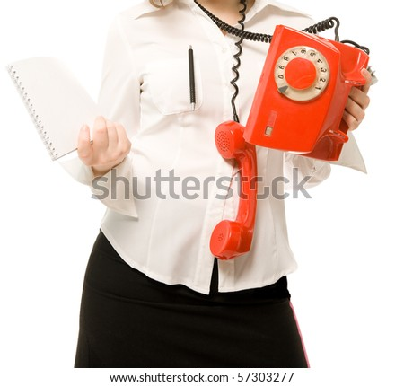 Businesswoman with telephone and notebook - stock photo