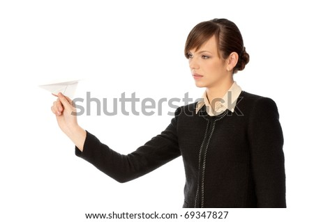 Businesswoman with white paper plane on the break - stock photo
