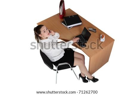 Businesswoman work on her workspace - stock photo