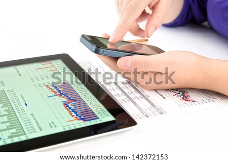 Businesswoman work with documents and tablet pc - stock photo