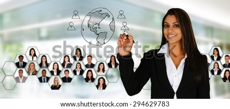 Businesswoman working at her office with a team - stock photo