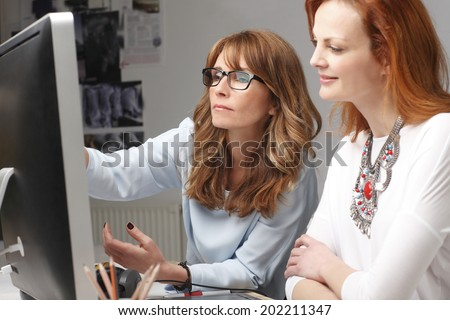 Businesswoman working at modern graphic studio. Teamwork.  - stock photo