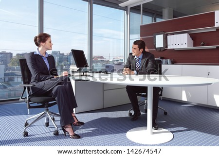businesswoman working in her office - stock photo