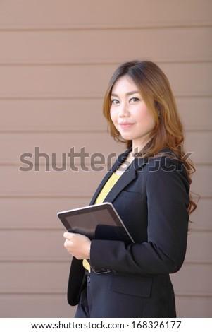 Businesswoman working on digital tablet  - stock photo