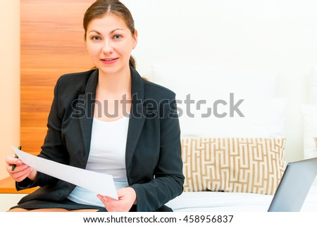 businesswoman working with documents in the hotel room - stock photo