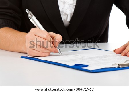 Businesswoman working with documents sign up contract close up view. - stock photo