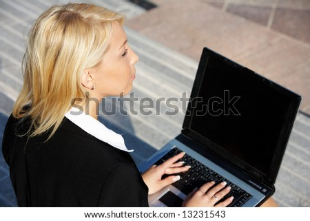 Businesswoman working with laptop computer - stock photo