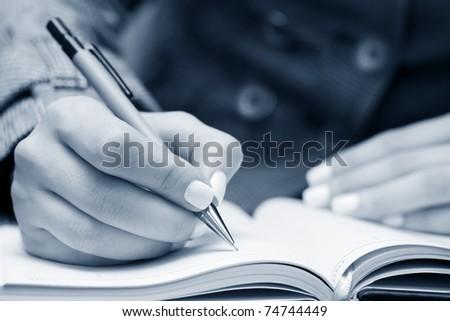 Businesswoman writing - stock photo